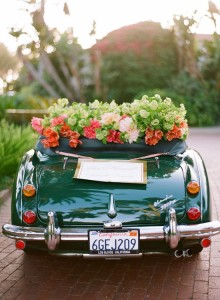 Floral decor on getaway car. Photography By / laciehansen.com, Planning By / ccmemorymakers.com, Event Floral Design By / flowerwild.com