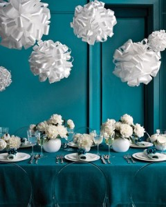 For a twist on the fancy chandelier, hang these fluffy pom-poms instead, which are a cinch to craft